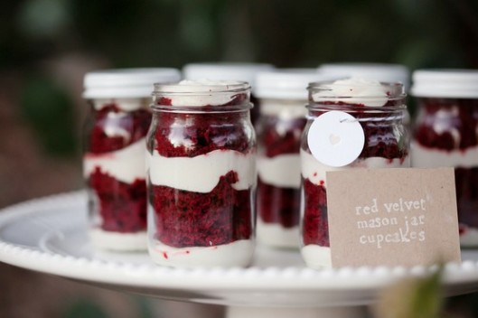 Red velvet cupcakes in mason jars from Style Me Pretty
