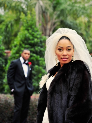 Sleek black fur coat (Bridal Musings)