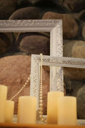 Frames, candles and string of pearls can add a nice, elegant touch (Style Me Pretty)